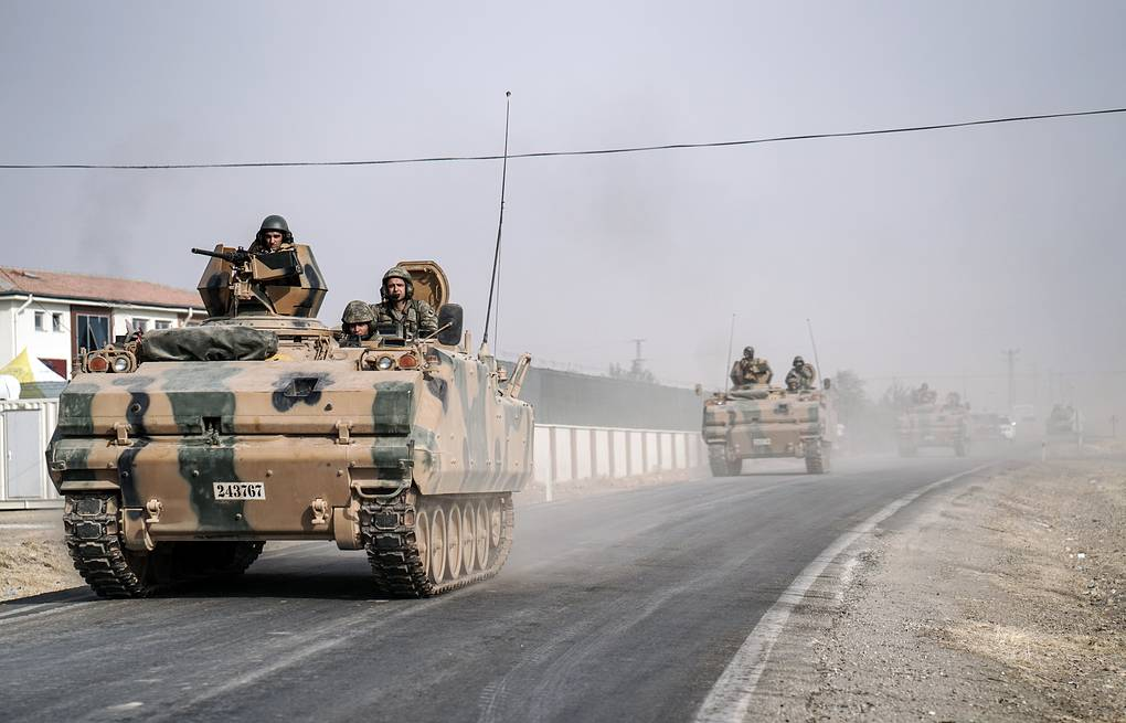 Turkish army tanks patroling near the Syrian border AP Photo/Halit Onur Sandal