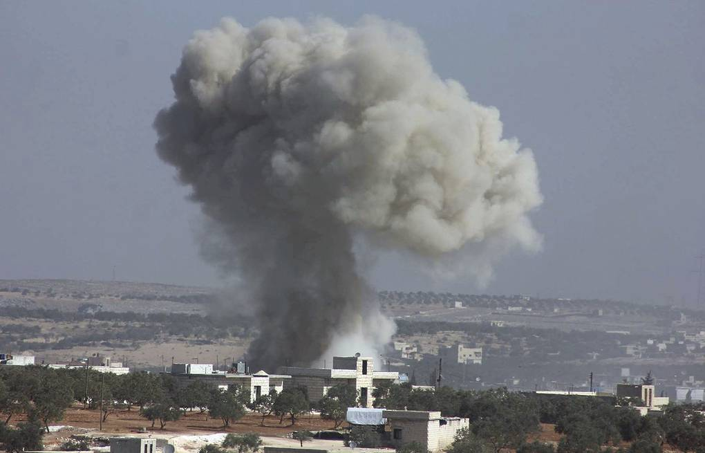 Alleged airstrike in the village of Hass on Oct. 26 Revolutionary Forces of Syria, via AP