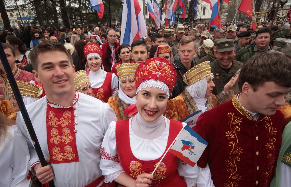 People in traditional Russian costume during a celebration marking the 3rd anniversary of the 2014 referendum on the political status of Crimea  Alexei Pavlishak/TASS