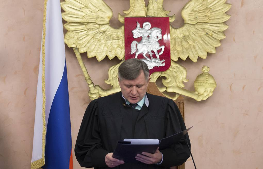 Russia's Supreme Court judge Yuri Ivanenko reads the decision to brand the Jehovah's Witnesses an extremist organization in Russia AP Photo/Ivan Sekretarev