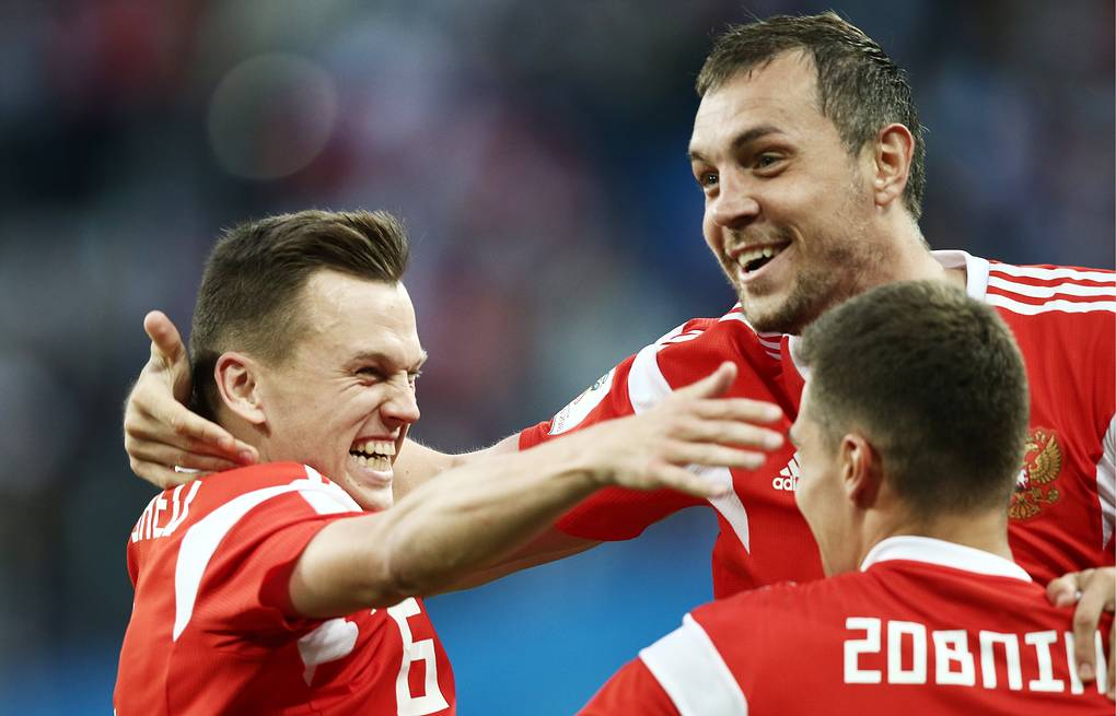 Russia's Denis Cheryshev, Artyom Dzyuba, and Roman Zobnin (L-R) celebrate scoring in the 2018 FIFA World Cup Group A Round 2 football match against Egypt at St Petersburg Stadium Valery Sharifulin/TASS