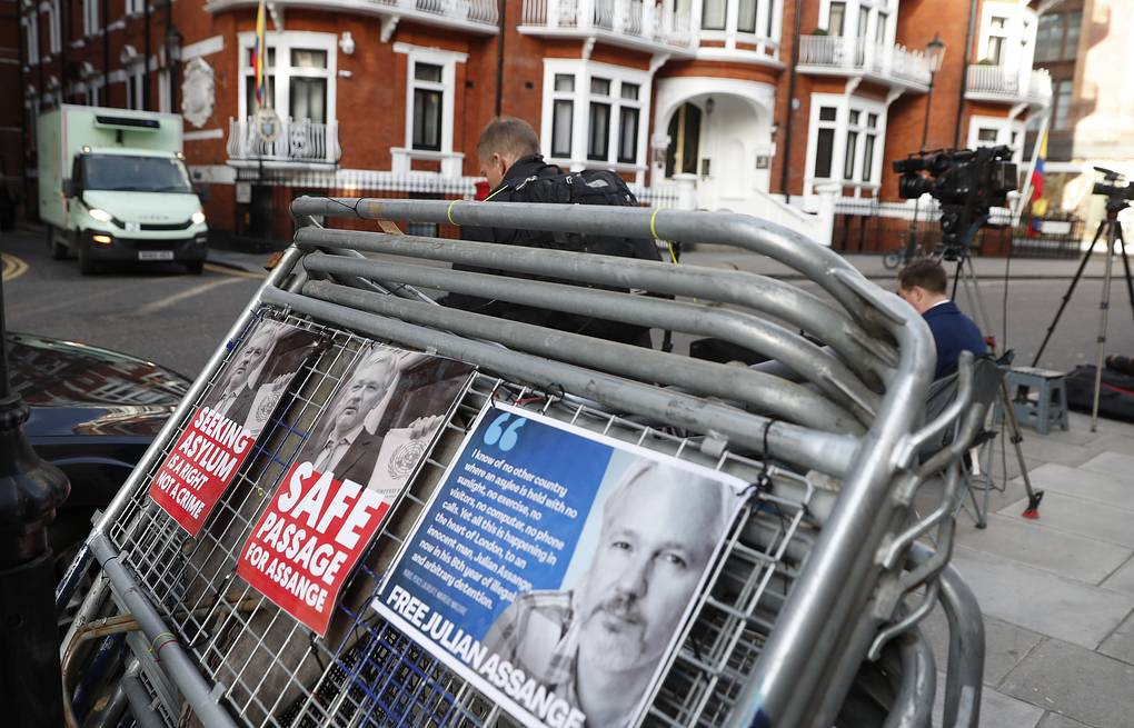 Placards on a crowd barriers outside the Ecuadorian Embassy in London AP Photo/Alastair Grant