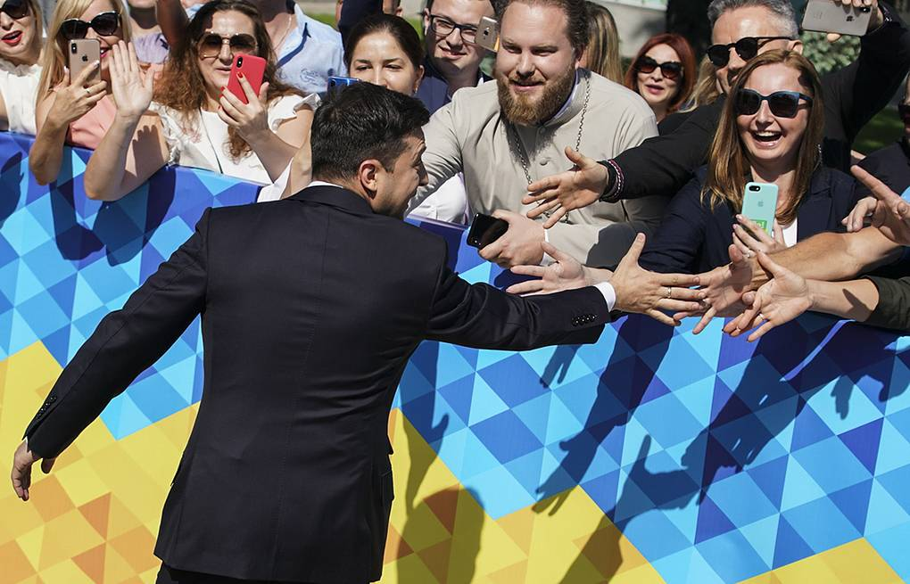 Ukrainian President Vladimir Zelensky greeting supporters  AP Photo/Evgeniy Maloletka