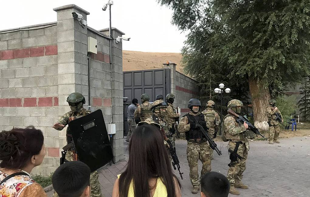 Kyrgyz special forces standing in guard at former president of Kyrgyzstan Almazbek Atambayev's residence  AKIpress via AP