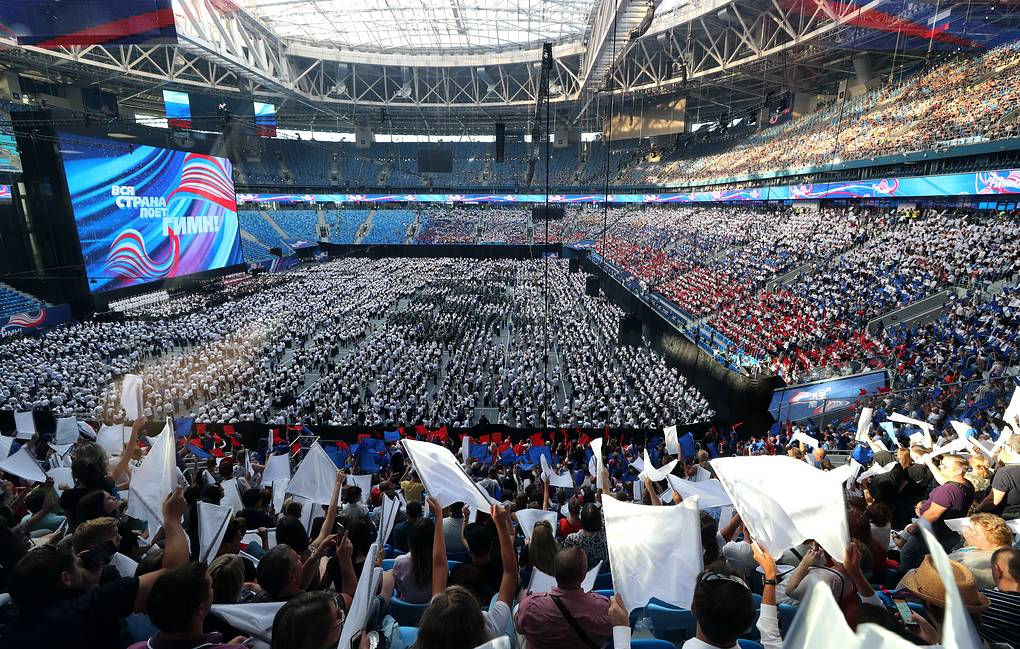 Participants in an event marking the 75th birthday of the melody of the Russian national anthem at Gazprom Arena Stadium Alexander Demianchuk/TASS