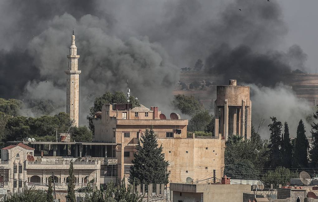 Smoke rising from targets inside Syria during bombardment by Turkish forces at Ras al-Ayn town EPA-EFE/SEDAT SUNA