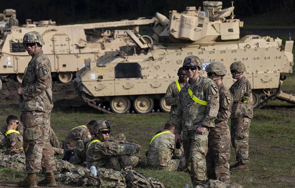 Members of the US Army after arriving at the Pabrade railway station in Lithuania AP Photo/Mindaugas Kulbis