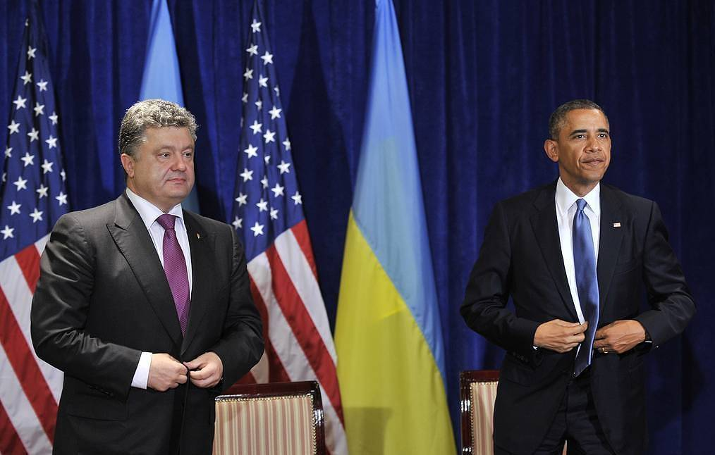 European Solidarity party leader Pyotr Poroshenko, left, and Barack Obama Nikolai Lazarenko/TASS