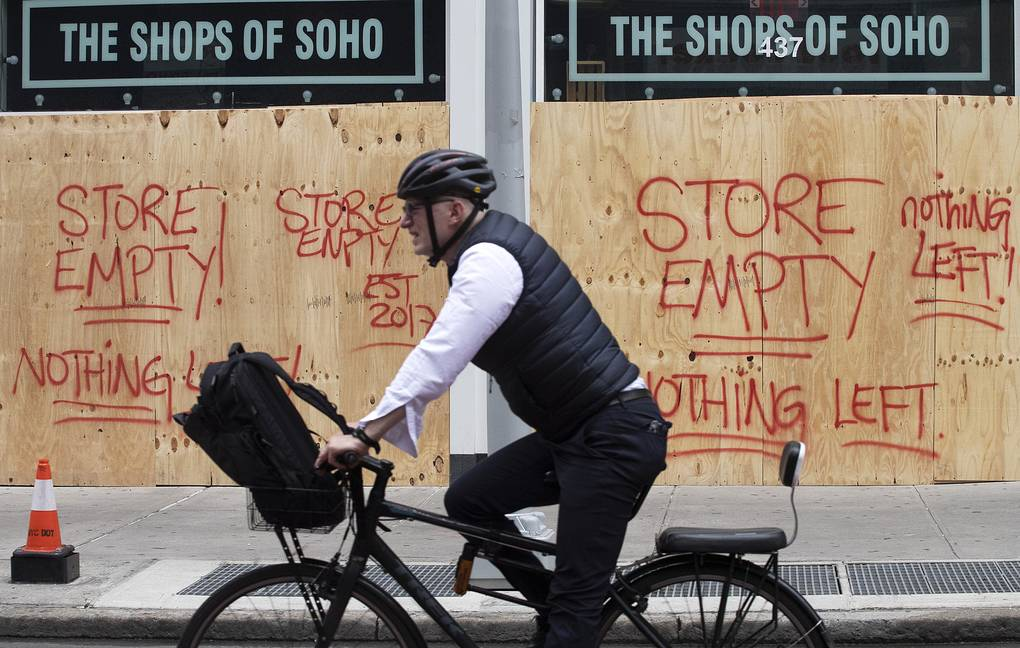 A cyclist passes the Shops of Soho, Wednesday, June 3, 2020, in New York AP Photo/Mark Lennihan