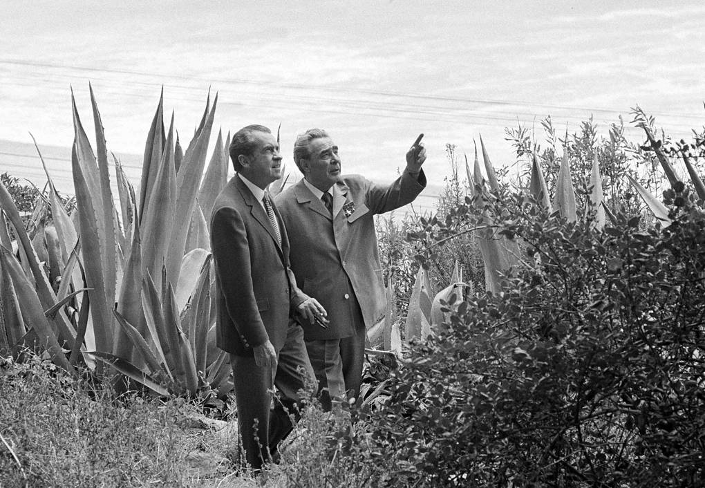In this June 23, 1973 file photo, with the Pacific Ocean in the background, President Richard Nixon, left, and Soviet Communist Party leader Leonid I. Brezhnev take a stroll on the grounds during a break in their talks at Nixon's home in San Clemente, Calif. AP Photo
