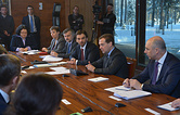 Russia's finance minister Anton Siluanov, Russia's prime minister Dmitry Medvedev and Russia's minister for open government Mikhail Abyzov (L-R) at a meeting with Open government experts