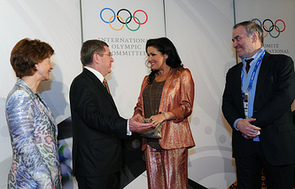International Olympic Committee (IOC) president Thomas Bach with wife Claudia, opera singer Anna Netrebko and conductor Valery Gergiev (L-R)