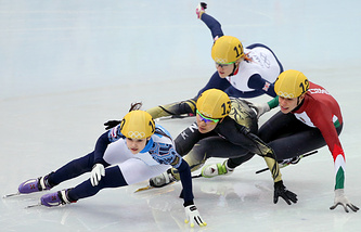 Sofia Prosvirnova (L) of Russia leads Yui Sakai of Japan, Elise Christie (top) of Great Britain and Andrea Keszler of Hunary
