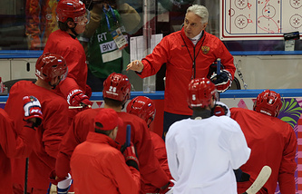 Head coach Zinetula Bilyaletdinov (R background) instructs his players during a training session