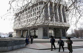 Cossacks patrol the area around the building of the Supreme Council of Crimea ahead of the referendum