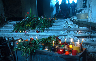 Lit candles and floral tributes inside the House of Trade Unions in Odessa where scores of demonstrators died after the building was set on fire during the May 2 clashes