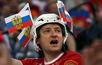 A fan of Russia cheers during the Ice Hockey World Championship