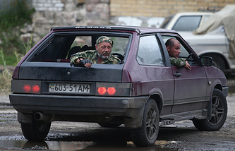 Militia fighters in Ukraine's Lisichansk in June, 2014