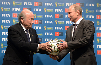 Russian President Vladimir Putin (R) and FIFA President Sepp Blatter (L) uring the official ceremony of handing over the FIFA World Cup 2018 signed certificate to Russia