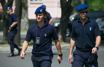Dutch police officers outside a hotel in the city of Donetsk