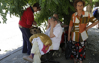 Luhansk citizens after a shelling attack
