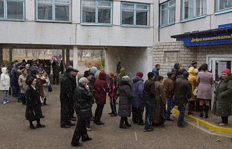 Donetsk citizens queuing outside one of the polling stations during the elections