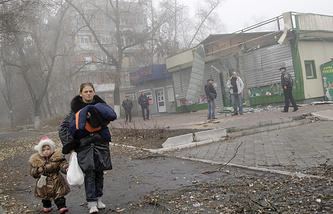 Residents near damaged building after shelling in Donetsk region