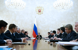 Russian Prime Minister Dmitry Medvedev at a meeting with officials from the economic block of the government