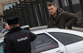 Alexei Navalny outside the office of the Russian Investigative Committee