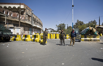 Police troopers standing guard at the entrance of the U.S. Embassy in Sanaa, Yemen