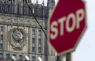 Russian Foreign Ministry building seen in the background of a stop sign