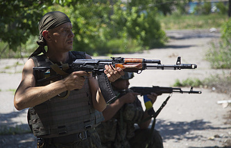 Ukrainian servicemen patrol the area in the town of Maryinka, east Ukraine