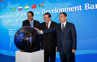 The president of the New Development Bank (NDB), Kundapur Vaman Kamath of India, China's Finance Minister Lou Jiwei and Shanghai's mayor Yang Xiong, attend the opening ceremony of the NDB in Shanghai