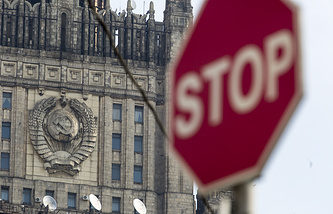 Russian Foreign Ministry seen in the background of a stop sign