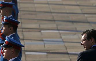 Serbian Prime Minister Aleksandar Vucic, right, inspects the honour guard