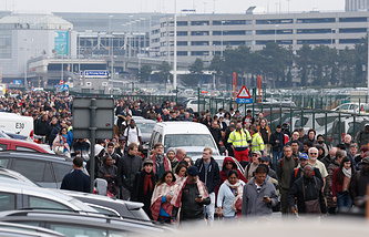 Passengers and airport staff evacuated from the terminal building after explosions at Brussels Airport in Zaventem, Belgium
