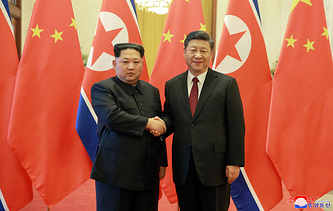 North Korean leader Kom Jong Un and Chinese President Xi Jinping