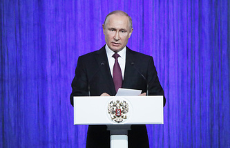 Russian President Vladimir Putin addresses the audience at a concert in the State Kremlin Palace marking Cosmonautics Day