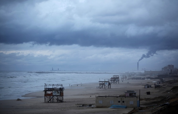Mediterranean beach in Gaza City during a rain storm