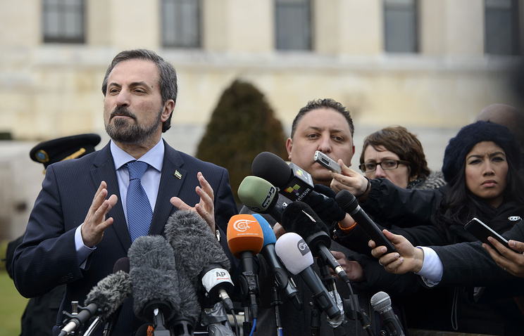 Louay Safi, spokesperson for the Syrian National Coalition, briefs the media, at the European headquarters of the United Nations, in Geneva