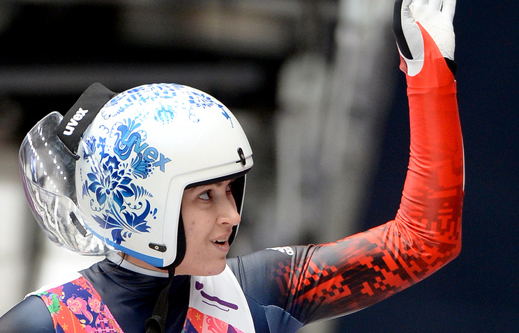 Tatyana Ivanova of Russia reacts after the third run of the Women's Luge competition