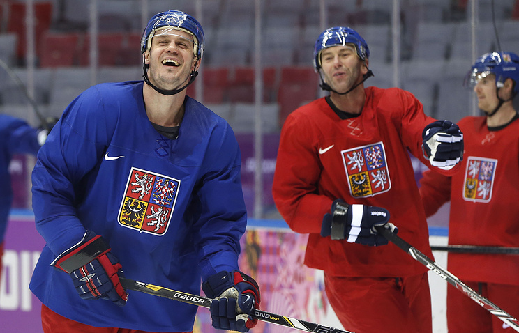 Czech Republic defenseman Lukas Krajicek laughs at a break in play during a training session