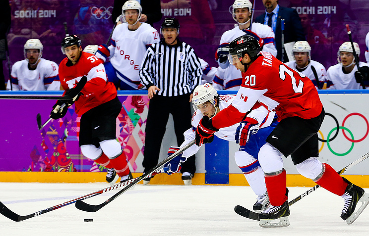 Mats Zuccarello (back) of Norway in action against John Tavares (front) of Canada during the Men's Preliminary Round Group B match between Canada and Norway