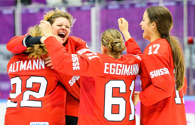 Members of Team Switzerland celebrates victory over Sweden