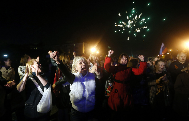 Residents of Donetsk celebrate after the referendum