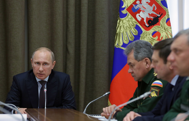Vladimir Putin (left) during a meeting on May 14