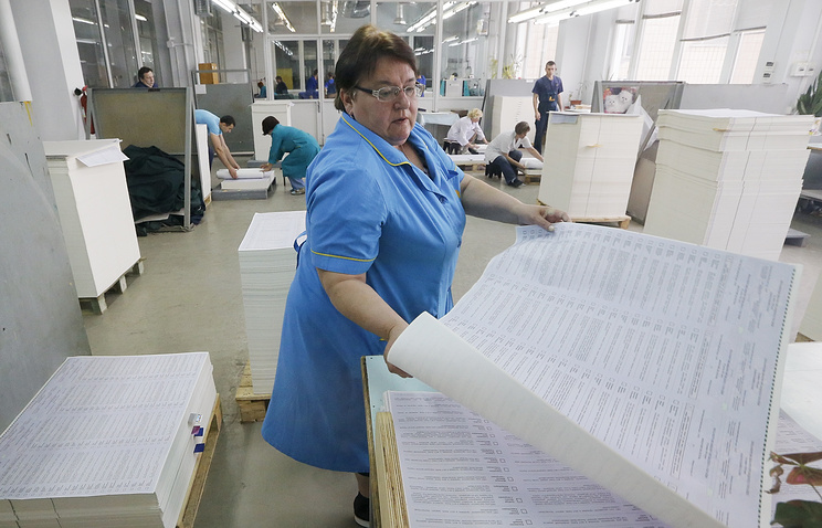 A worker examines papers for the presidential election in Ukraine