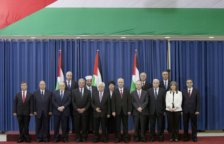 Palestinian unity government members including President Mahmoud Abbas