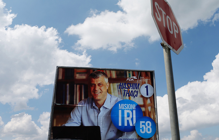 An election poster of the Kosovo's Prime Minister and chairman of Democratic Party of Kosovo (PDK) Hashim Thaci