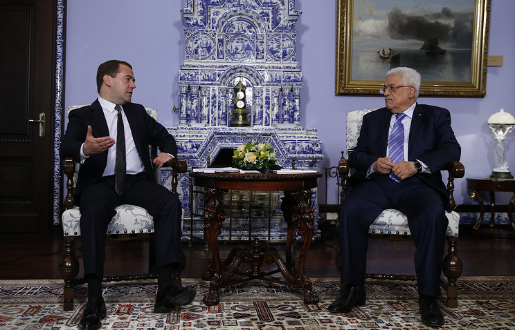Russian Prime Minister Dmitry Medvedev and leader of the State of Palestine Mahmoud Abbas